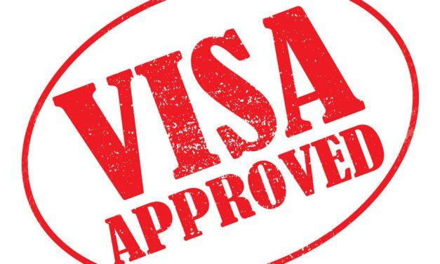 Visa Aprobada para una Compañía de Venta de Autos a través del Consulado de los Estados Unidos en Bogotá, Colombia.